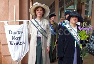 1362784292-helen-pankhurst-and-olympic-suffragettes-walk-through-london_1853757